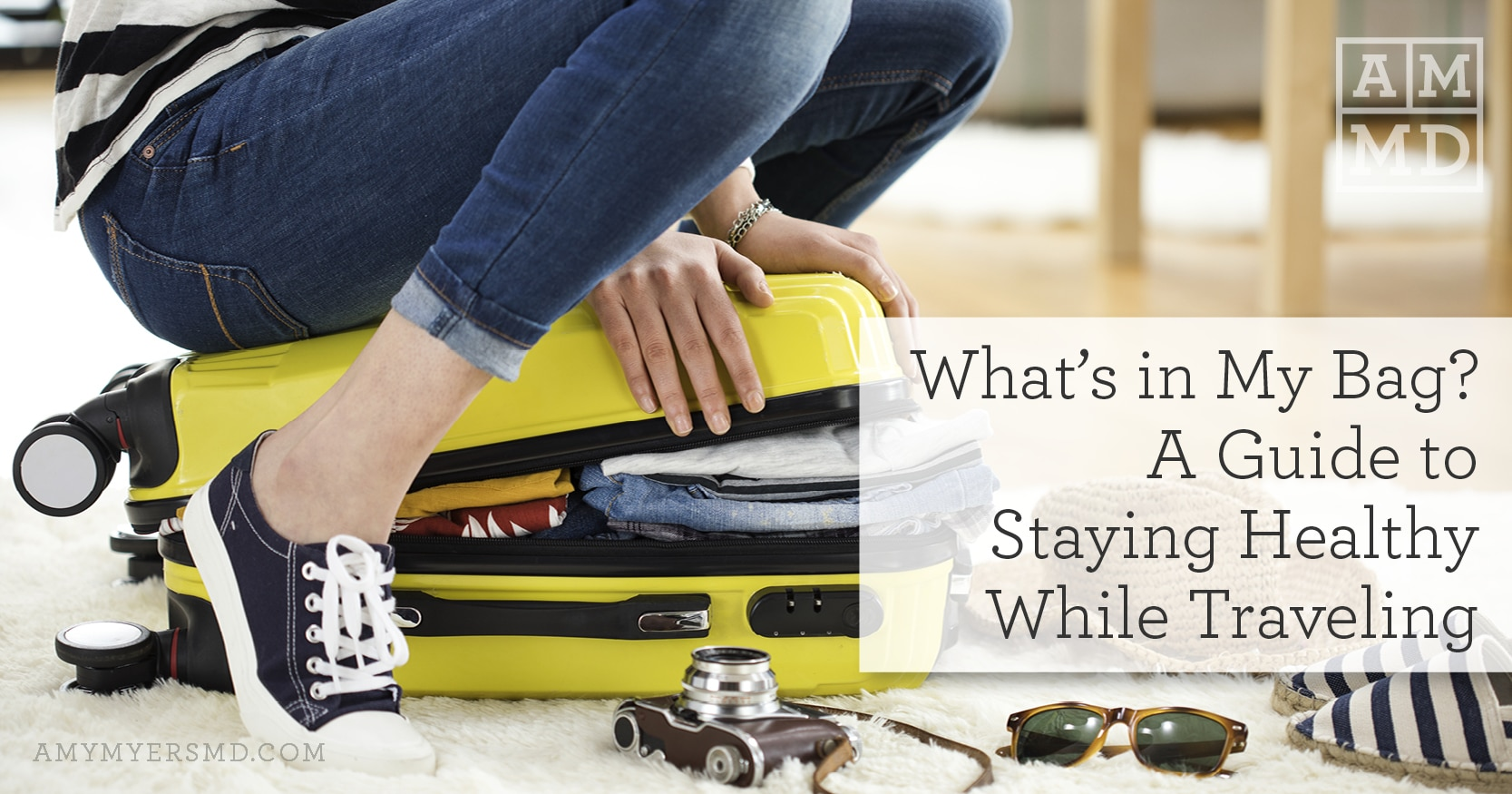 A Guide to Staying Healthy While Traveling - A Woman Trying to Close Her Suitcase - Featured Image - Amy Myers MD