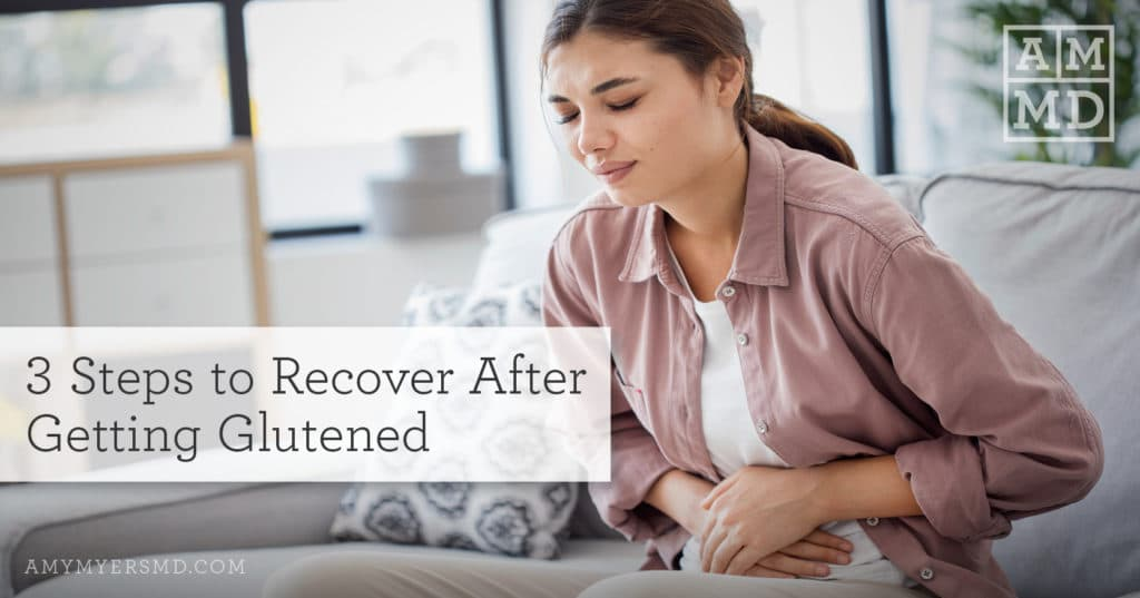 3 Steps to Recover After Getting Exposed to Gluten - Woman In Pain Holding Her Stomach - Amy Myers MD