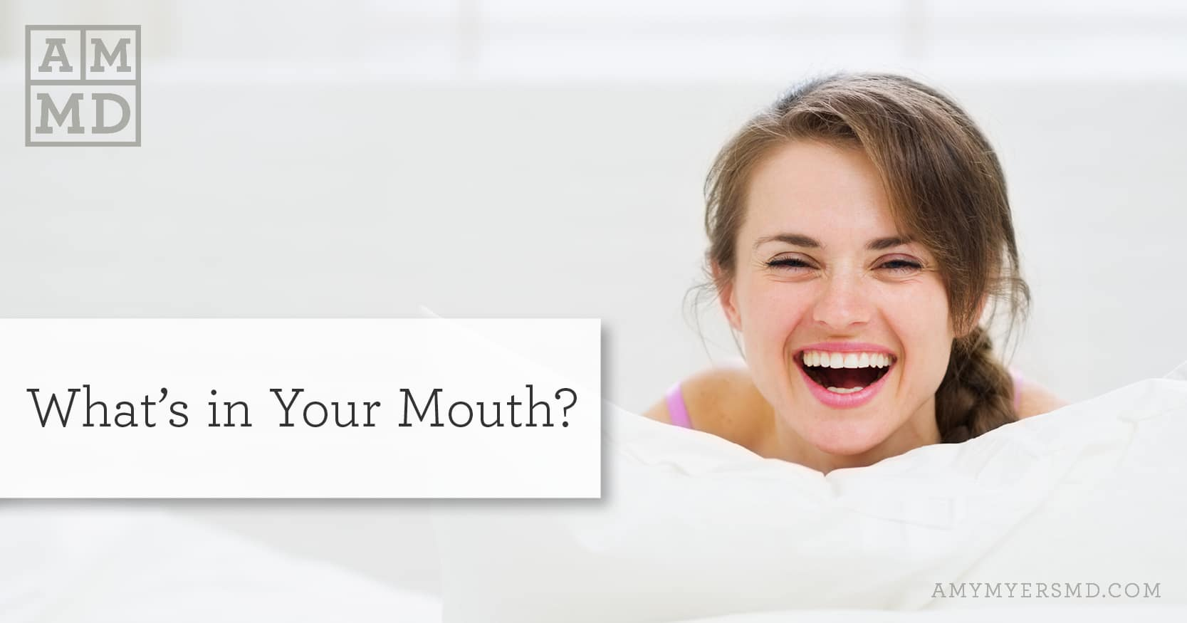 What's in Your Mouth? - Smiling woman on a pillow - Featured Image - Amy Myers MD