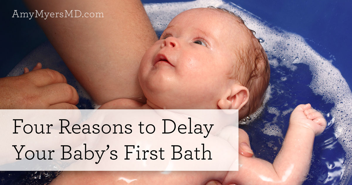 Four Reasons to Delay Your Baby's First Bath - A Baby Being Bathed - Featured Image - Amy Myers MD