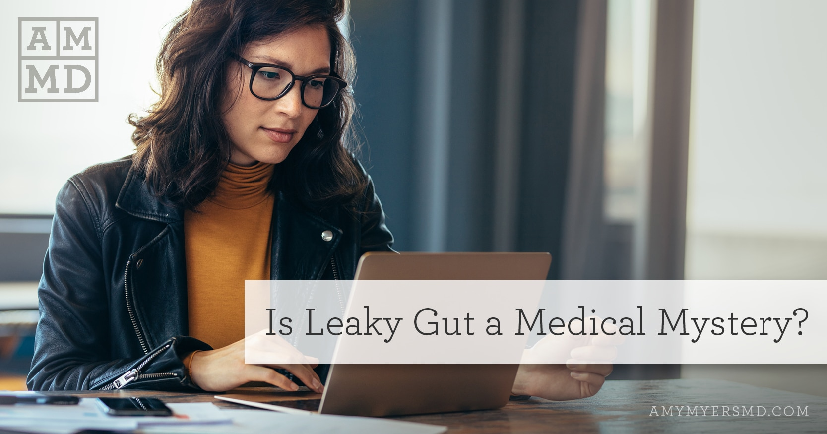 Is Leaky Gut a Medical Mystery? - Woman with a laptop computer - Featured Image - Amy Myers MD