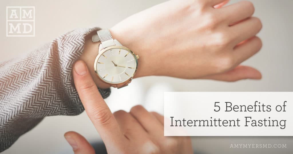 5 Benefits of Intermittent Fasting - A Person Looking at Their Watch - Featured Image - Amy Myers MD